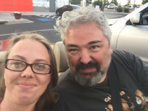 My lovely bride and I with the top down enjoying a day out together.